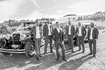Groomsmen looking cool in front of Vintage wedding cars