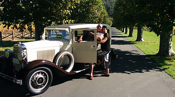 A couple taking vintage car on self-drive hire to the Mission estate winery