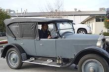 David Brock-Jest in his authentic art deco tour car