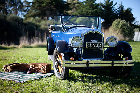 Stopping for a picnic while on tour in an old-timer car.