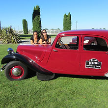 Two lovely ladies having fun on tour in an old Citroen
