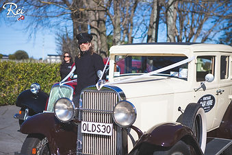 Old wedding cars with chauffeur