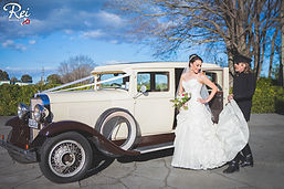 Happy bride being helped from car by vintage driver