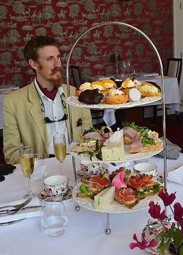 Art Deco Gent enjoying a tasty high tea with bubles