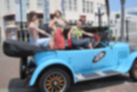 Beautiful Retro models enjoying Napiers only open top vintage car tour.