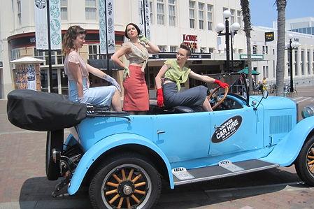 Beautiful Retro models enjoying Napiers only open top vintage car tour.