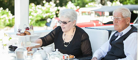 Older couple enjoying a spot of High Tea at Ormlie Lodge with a Vintage car