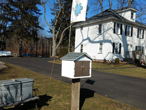 Webster family puts a puzzling twist on their Little Free Library