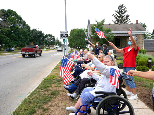 Maplewood residents wave flags on Main Street