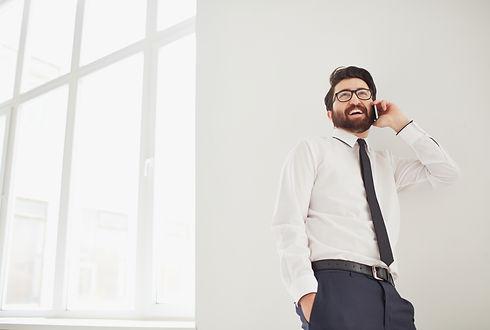 worker-talking-phone-close-window.jpg