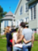 Happy family with agent realtor near new house.jpg