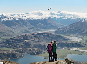 New Zealand Trip Planner | GeoLuxe Travel | Couple hiking in the mountains