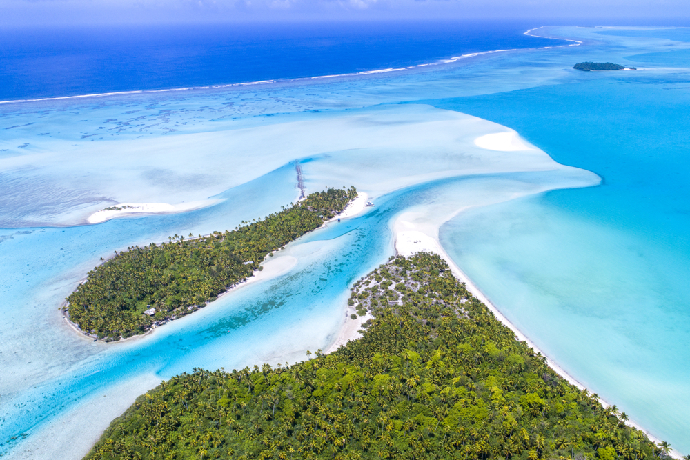 Cook Islands Trip Planner | GeoLuxe Travel | overhead view of an island