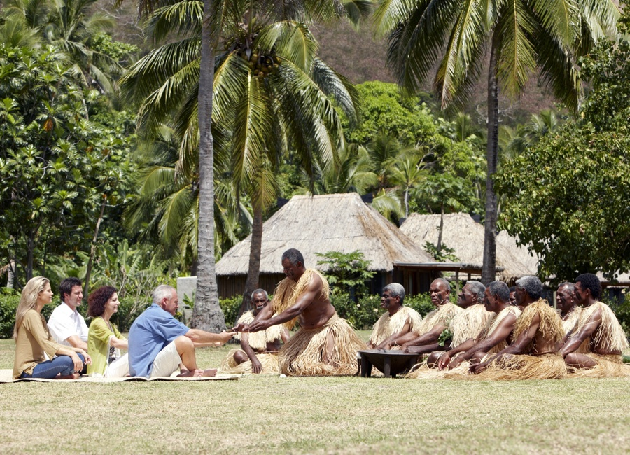 Fiji Trip Planner | GeoLuxe Travel | people meditating in the tropics