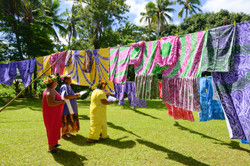 Cook Islands Trip Planner | GeoLuxe Travel | colorful dyed fabric on a clothes line