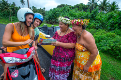 Cook Islands Trip Planner | GeoLuxe Travel | smiling people on a scooter