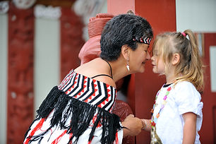 New Zealand Trip Planner | GeoLuxe Travel | Woman touching noses with little girl