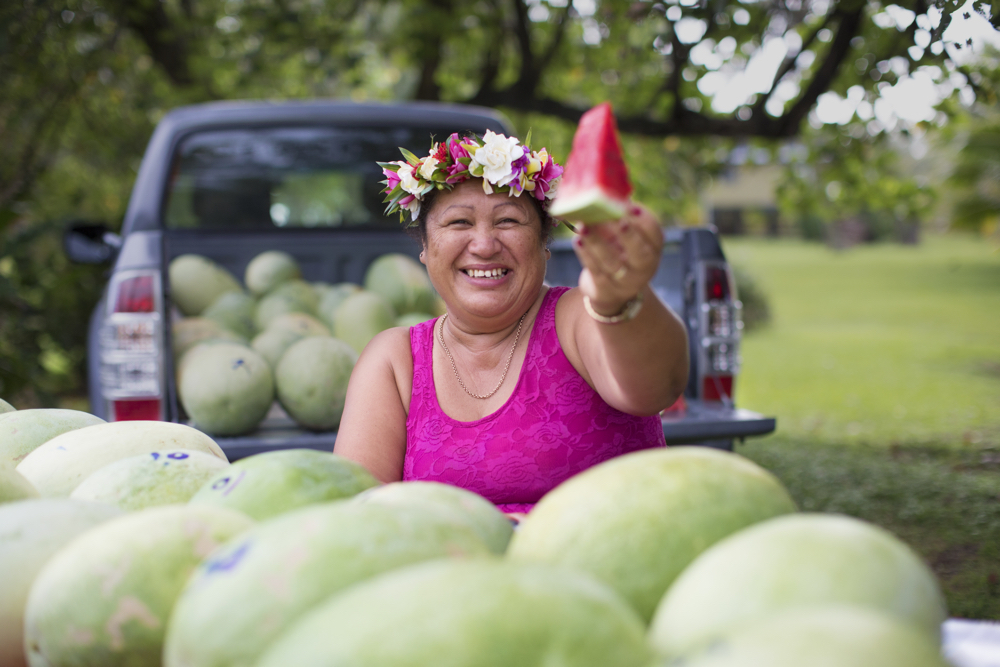 Cook Islands Trip Planner | GeoLuxe Travel | smiling woman holding watermelon