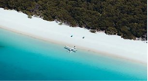 Custom Australia Vacation | GeoLuxe Travel | small airplane on beach