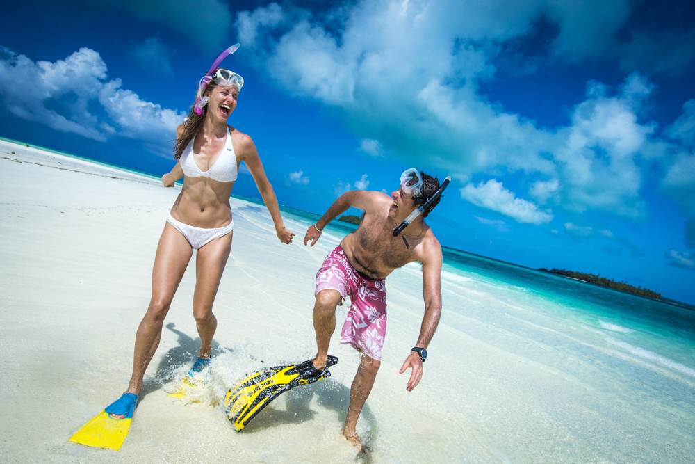 Cook Islands Trip Planner | GeoLuxe Travel | happy couple with snorkeling gear