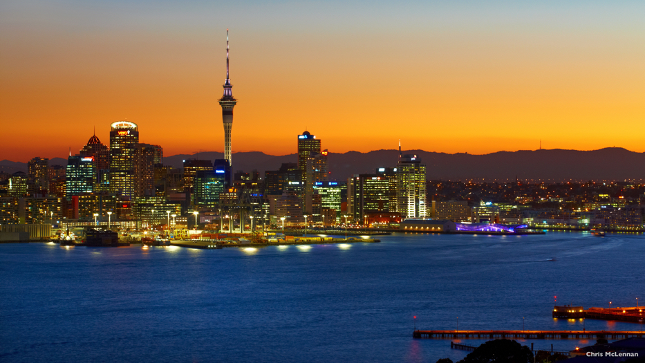 New Zealand Trip Planner | GeoLuxe | waterfront city at dusk