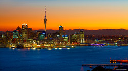 New Zealand Trip Planner   GeoLuxe   waterfront city at dusk