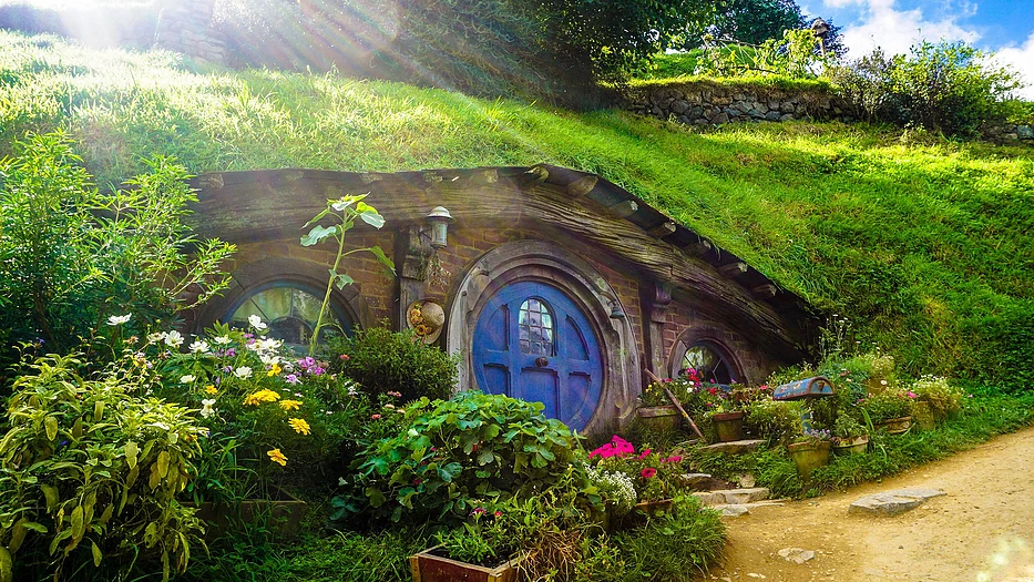 New Zealand Trip Planner | GeoLuxe | hillside Hobbit hut