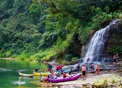 Fiji Trip Planner   GeoLuxe Travel   people in boats near a waterfall