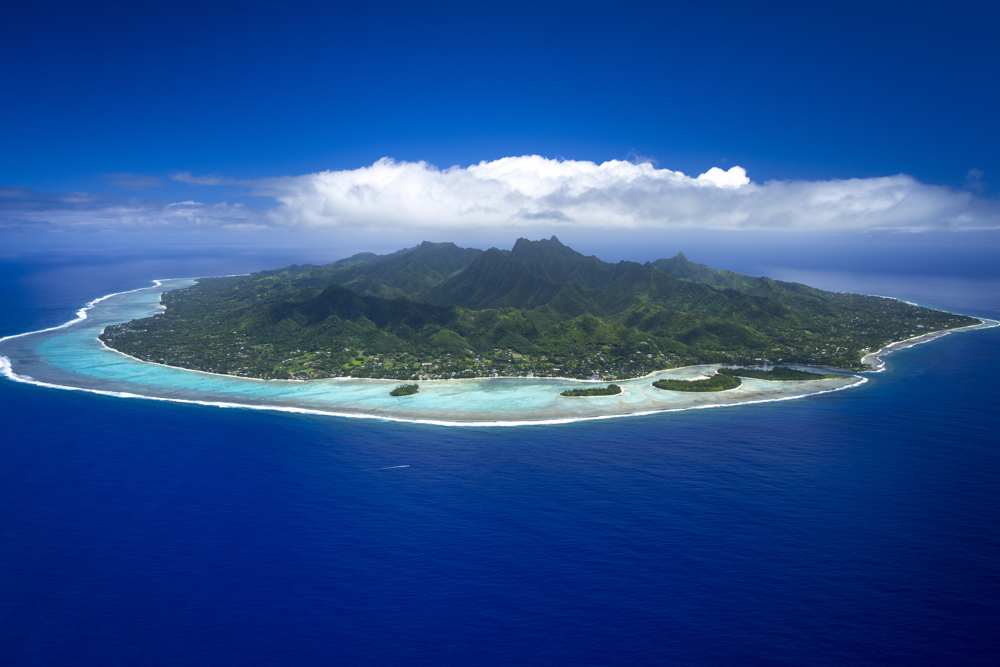 Cook Islands Trip Planner | GeoLuxe Travel | aerial view of an island