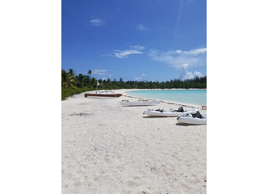 Tahiti Trip Planner | GeoLuxe | boats on a beach
