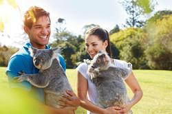 Custom Australia Vacation | GeoLuxe | couple holding koalas