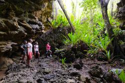 Cook Islands Trip Planner | GeoLuxe Travel | people hiking in the tropics