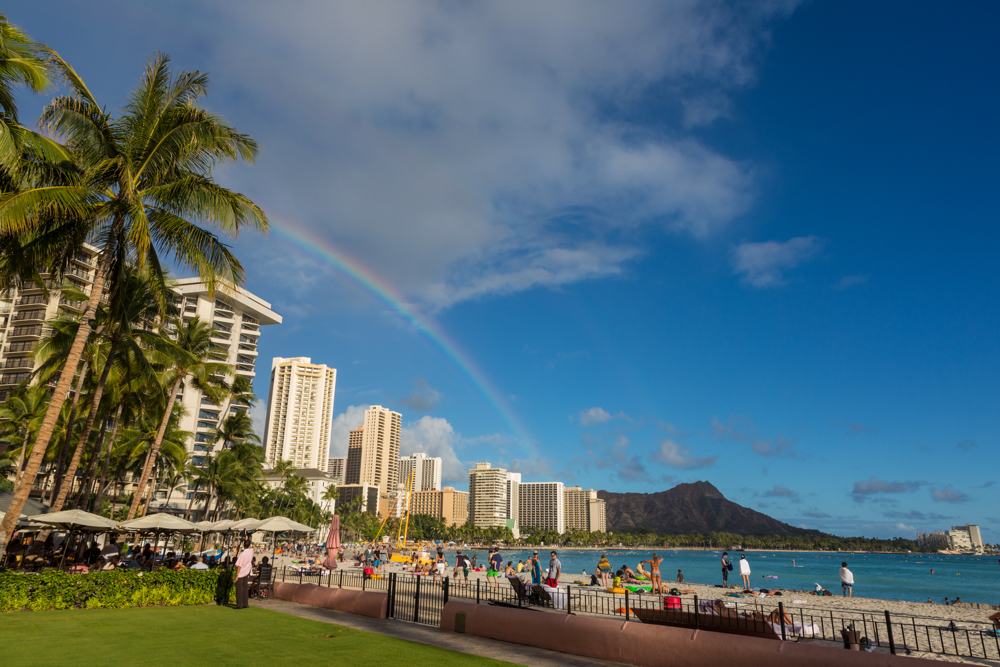 Hawaii Trip Planner | GeoLuxe Travel | rainbow on Hawaiian beach