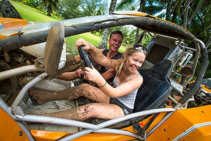 Cook Islands Trip Planner | GeoLuxe Travel | muddy couple dune buggy driving