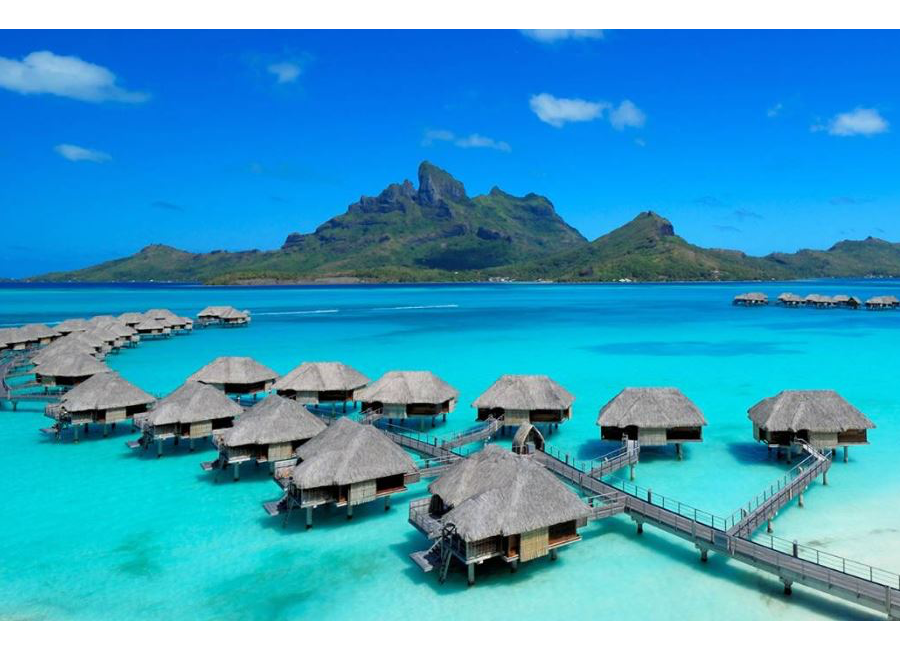 Tahiti Trip Planner | GeoLuxe | over water bungalows