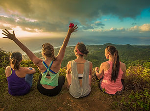 Cook Islands Trip Planner | GeoLuxe Travel | four women sitting on a mountain