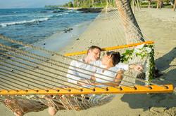 Hawaii Trip Planner | GeoLuxe Travel | couple sleeping in hammock