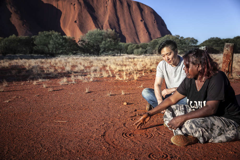 Custom Australia Vacation | GeoLuxe | couple sitting in Australian outback