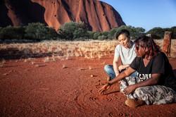 Custom Australia Vacation | GeoLuxe | couple sitting in Australian outback