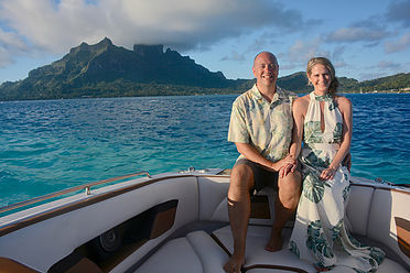 GeoLuxe Travel Testimonial | couple on a boat in the ocean smiling | Luxury Travel Consultant
