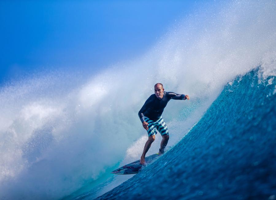 Fiji Trip Planner | GeoLuxe Travel | man surfing