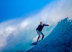 Fiji Trip Planner   GeoLuxe Travel   man surfing