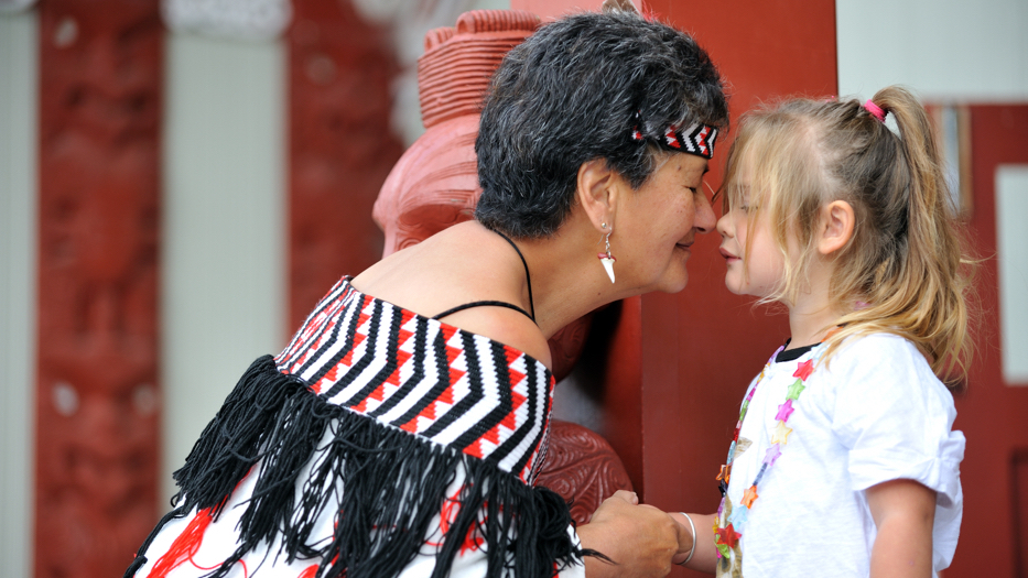 New Zealand Trip Planner | GeoLuxe | woman touching noses with little girl
