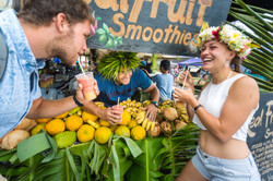 Cook Islands Trip Planner | GeoLuxe Travel | couple smiling at a smoothie stand