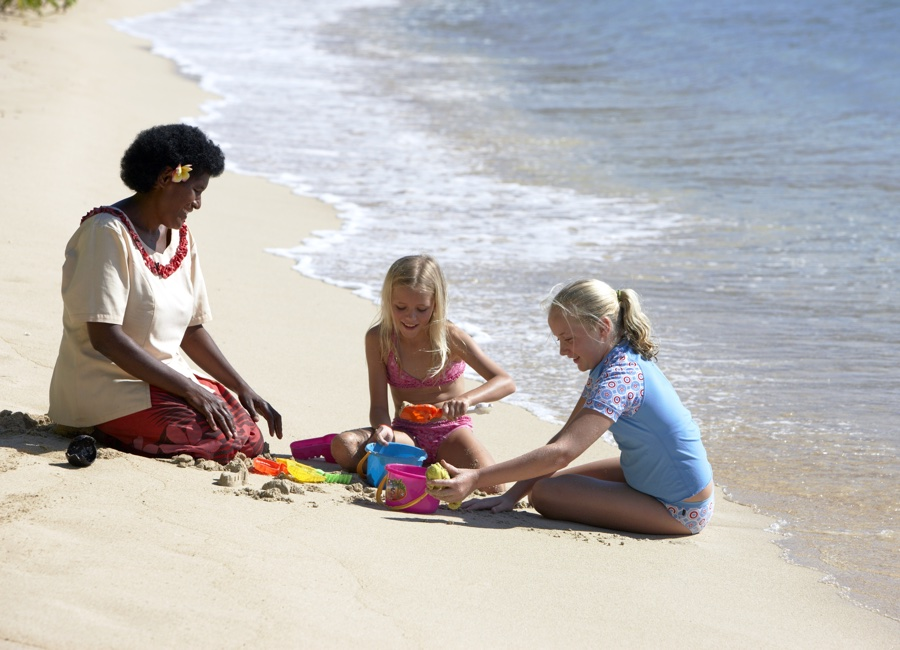 Fiji Trip Planner | GeoLuxe Travel | woman and children on beach