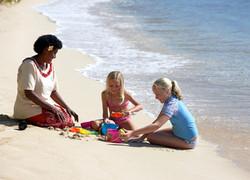 Fiji Trip Planner   GeoLuxe Travel   woman and children on beach