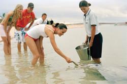 Custom Australia Vacation | GeoLuxe | people looking at ocean life