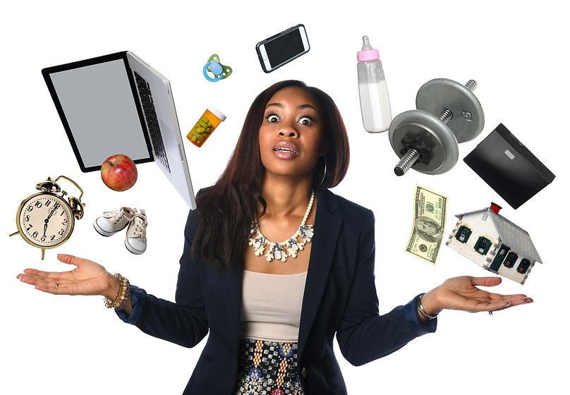 African American businesswoman juggling