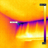 Thermal imaging, identifying draughts flowing between the edge of the ceiling board and a beam.