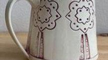 Hand-built flower mug